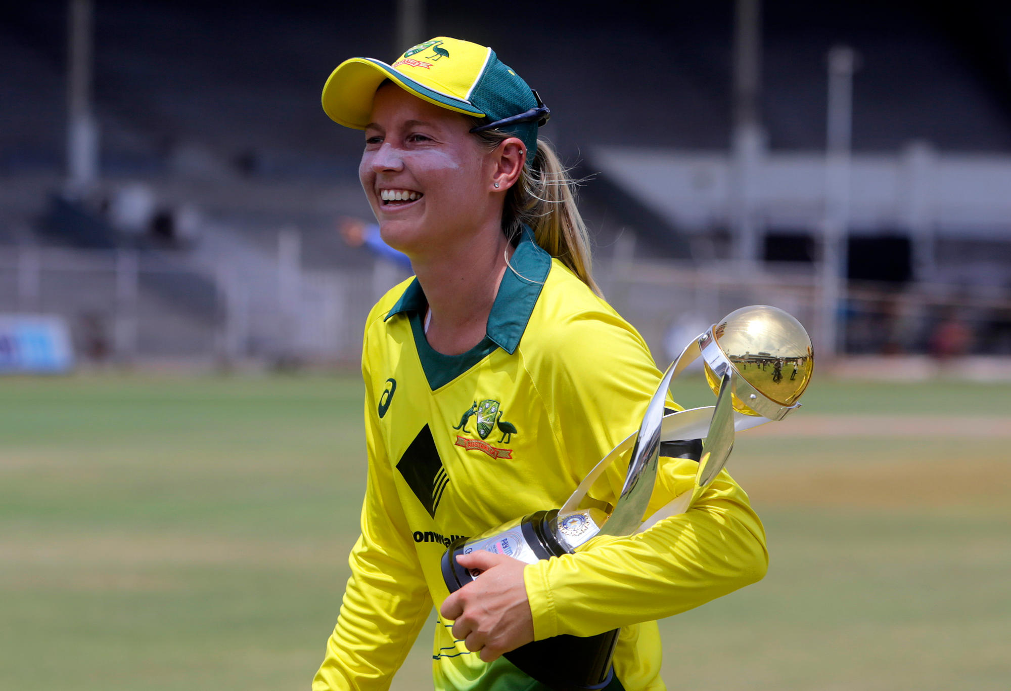 Australia's captain Meg Lanning with the trophy smiles after winning the final of Women's cricket T20 Triangular Series.