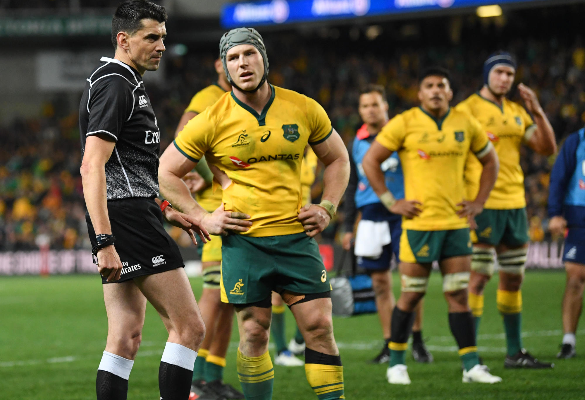 Australia's David Pocock waits to speak with match referee Pascal Gauzere.