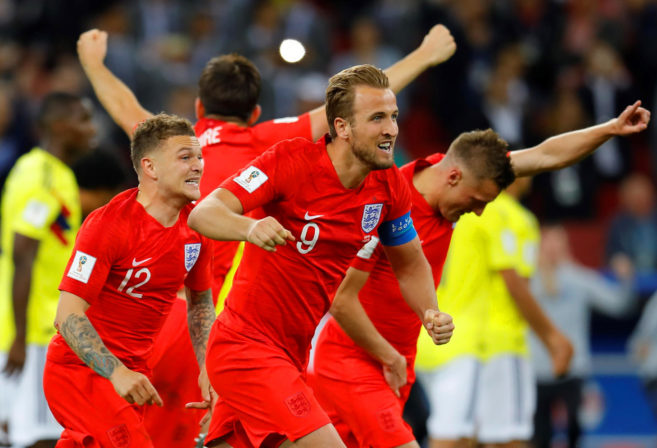 Harry Kane, Kieran Trippier and Jamie Vardy celebrate for England.