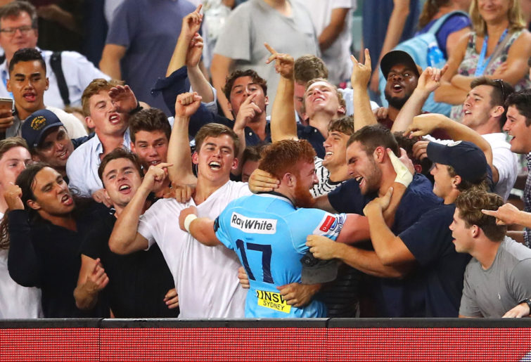 Harry Johnson-Holmes celebrates with Waratahs fans.