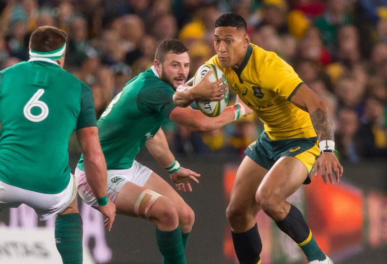 Israel Folau tries to beat Irish players