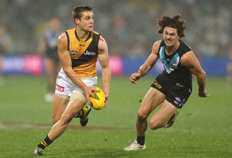 Jayden Short of the Tigers competes with Darcy Byrne-Jones of the Power during the 2016 AFL Round 15 match between Port Adelaide Power and the Richmond Tigers at Adelaide Oval on July 1, 2016 in Adelaide, Australia.