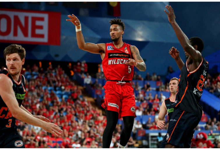 Jean-Pierre Tokoto of the Wildcats in action against the Cairns Taipans.
