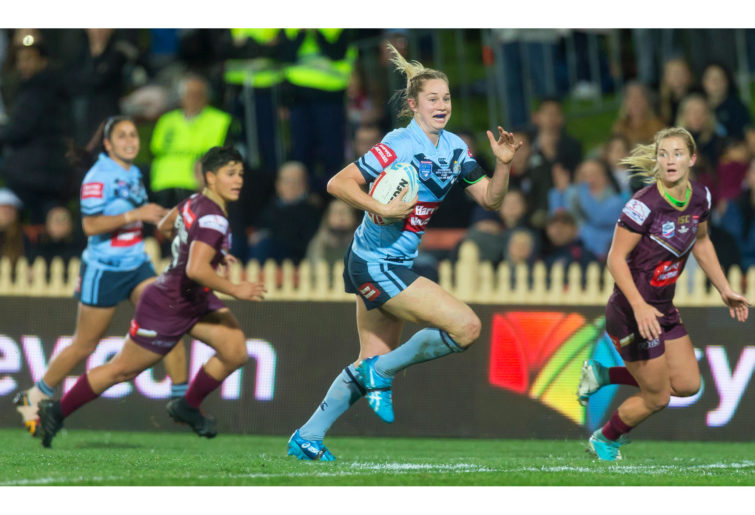 Kezie Apps of the Blues makes a break during the Women's State of Origin match.