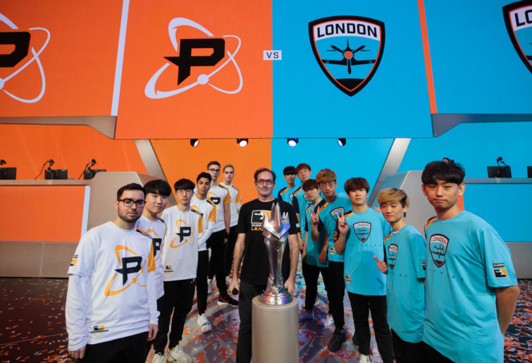 Members of the London Spitfire and Philadelphia Fusion esports teams pose ahead of their Overwatch League grand final clash.