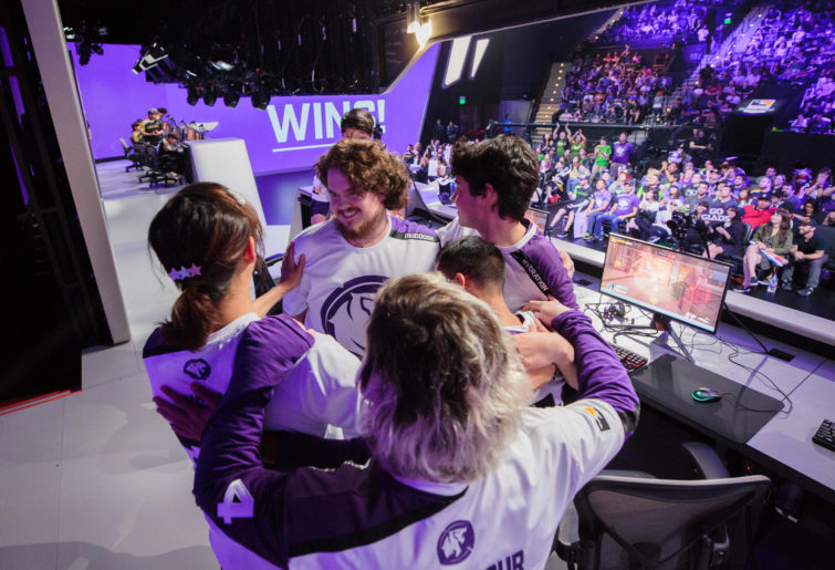 Members of the Los Angeles Gladiators Overwatch League team celebrate a victory on the esports stage.