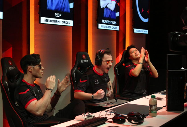 Members of the Melbourne Order esports team celebrate their Street Fighter victory at the Elite Series.