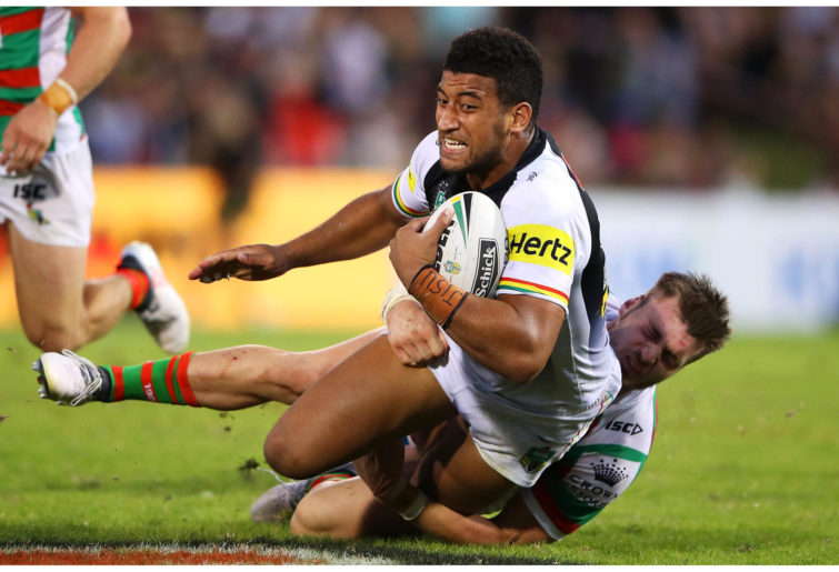 Viliame Kikau of the Panthers is tackled during match against Rabbitohs.