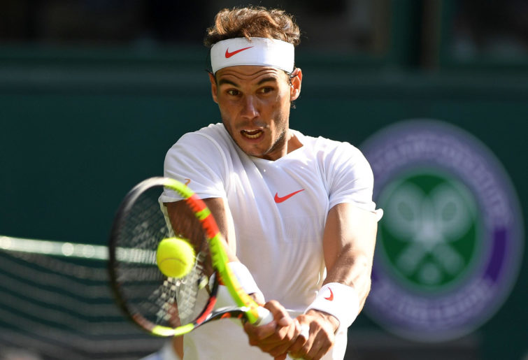 Rafael Nadal hits at Wimbledon.