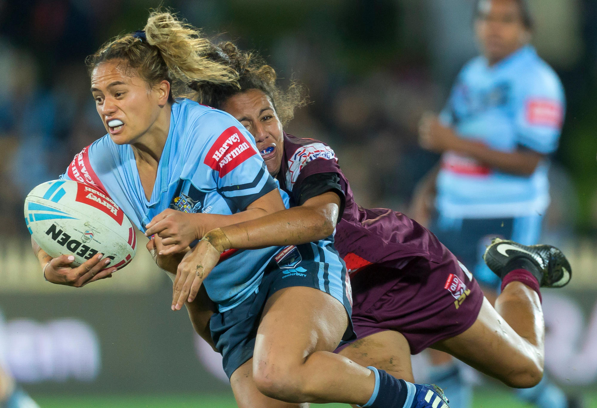 Tallisha Harden of the Maroons tackles Nita Maynard of the Blues during the Women's State of Origin match.