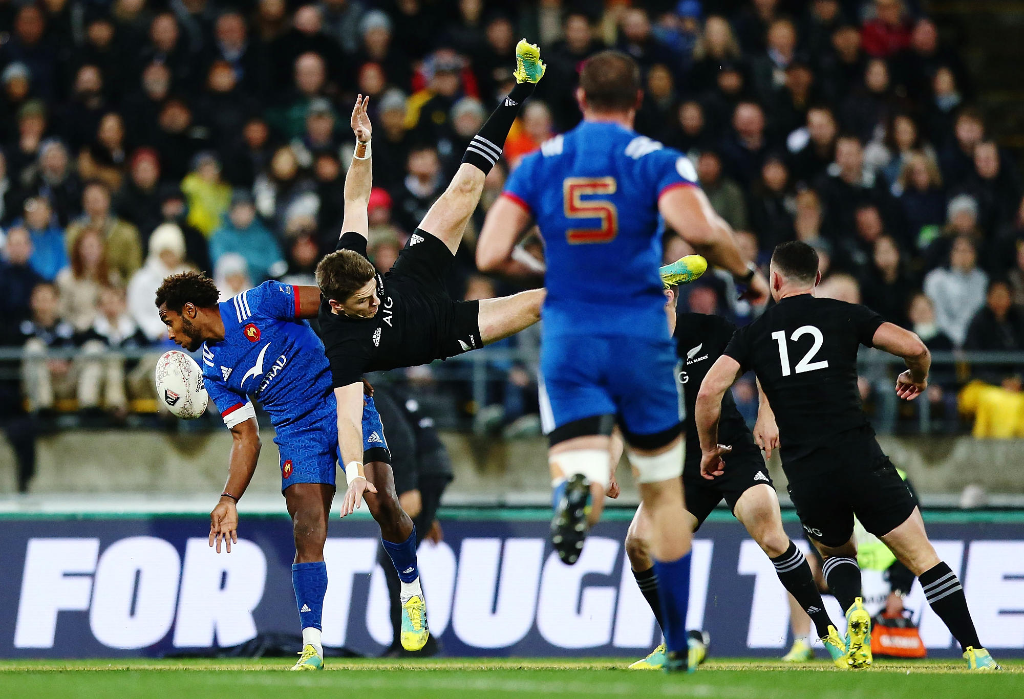 Benjamin Fall of France tackles Beauden Barrett of the All Blacks in the air