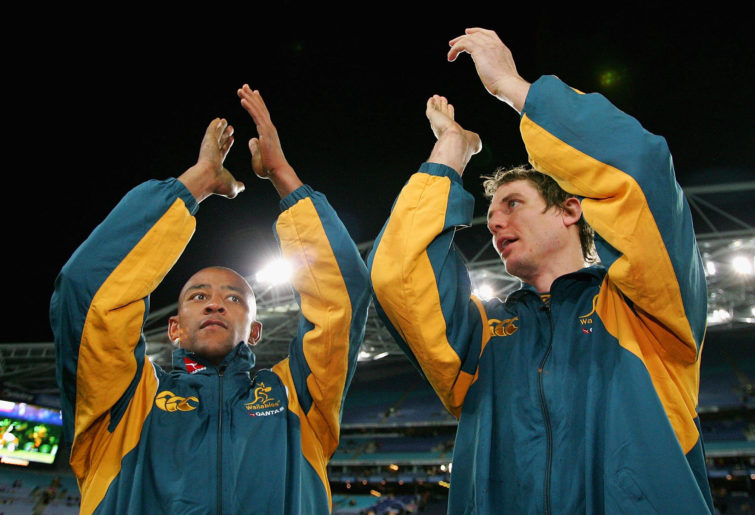 George Gregan and Stephen Larkham of the Wallabies thank fans