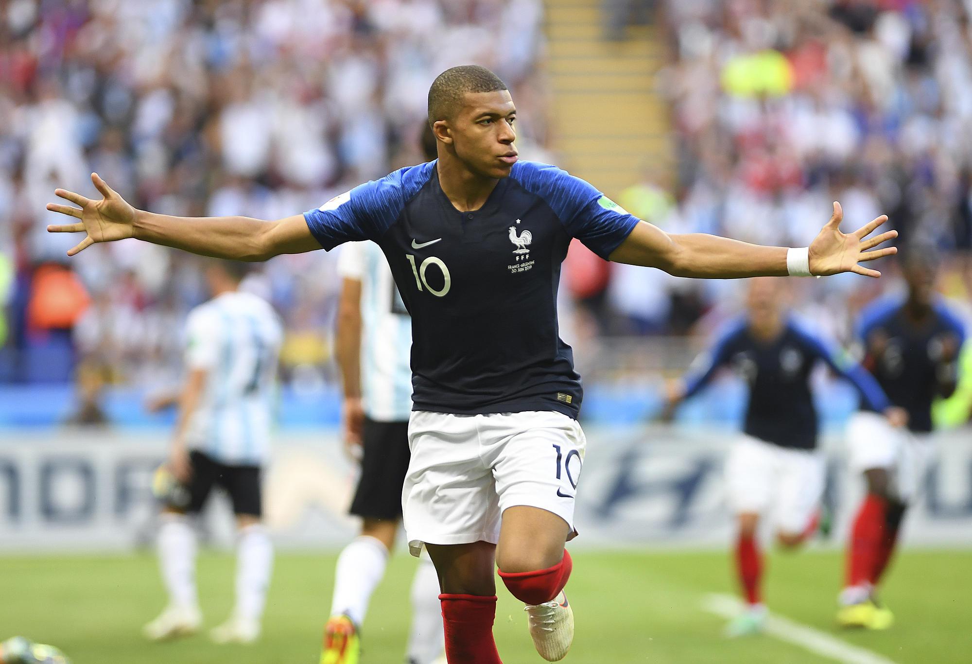 Kylian Mbappe celebrates scoring for France
