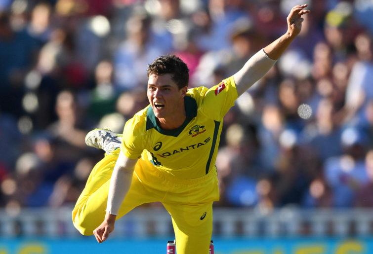 Mitchell Swepson of Australia bowls against England