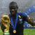 France's midfielder N'Golo Kante poses with the World Cup trophy