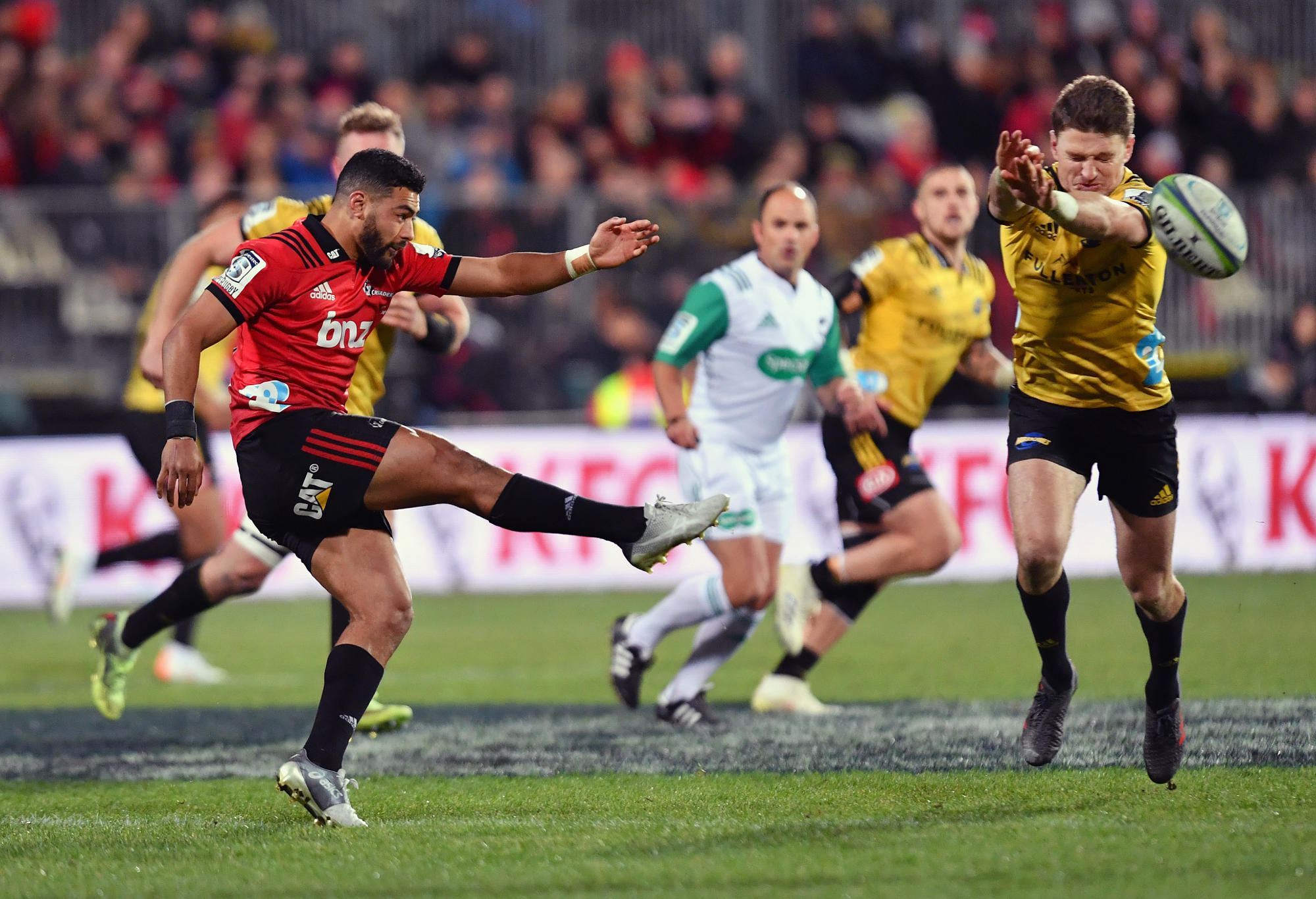Richie Mo'unga of the Crusaders kicks the ball