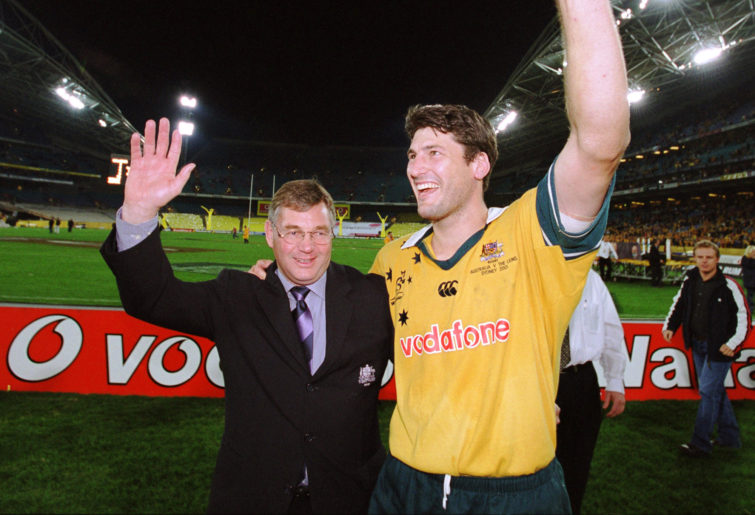 Rod MacQueen celebrates with John Eales after their series victory over the Lions