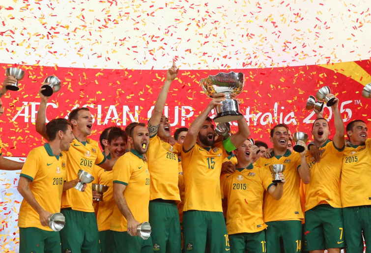 Australia celebrate with the trophy after the 2015 Asian Cup final match against Korea Republic.