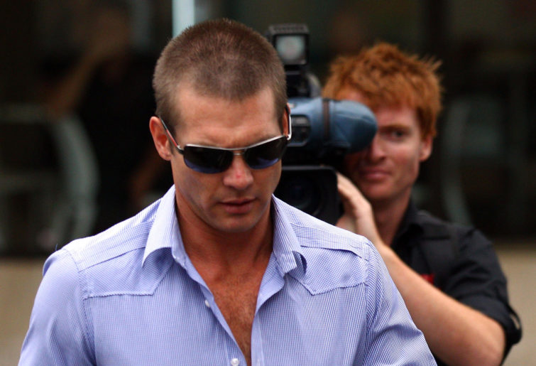 Ben Cousins arrives at a magistrates' court on Perth, pursued by media.