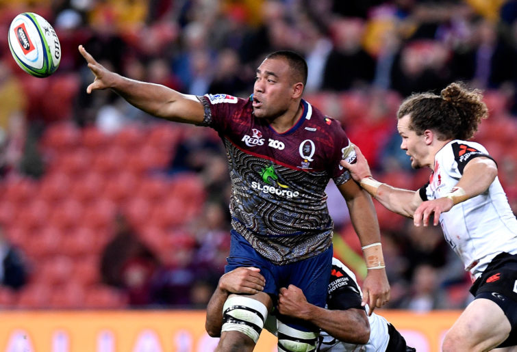 Caleb Timu of the Queensland Reds offloads the ball in a Super Rugby match.