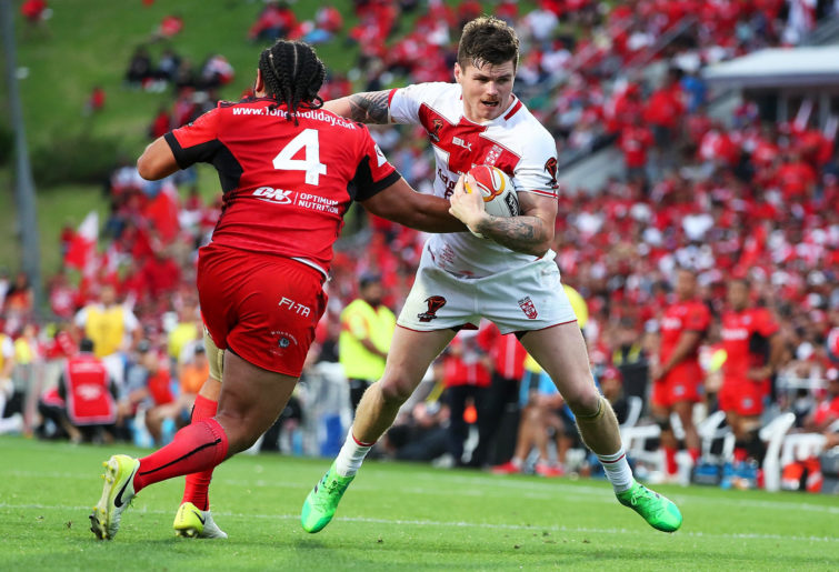 John Bateman fends Konrad Hurrell during the Rugby League World Cup.