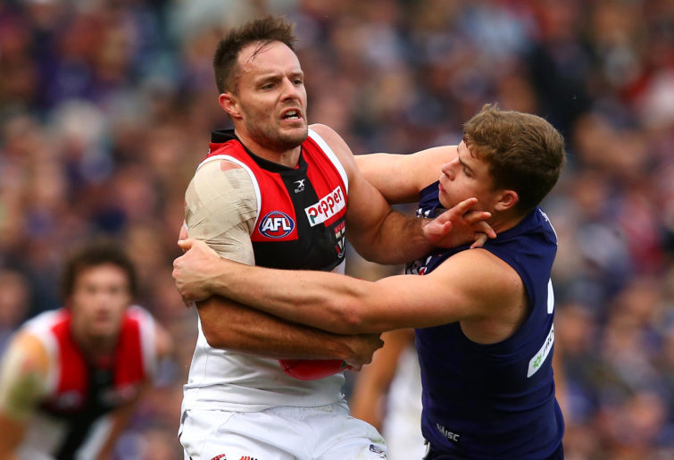 Nathan Brown is tackled by Sean Darcy.