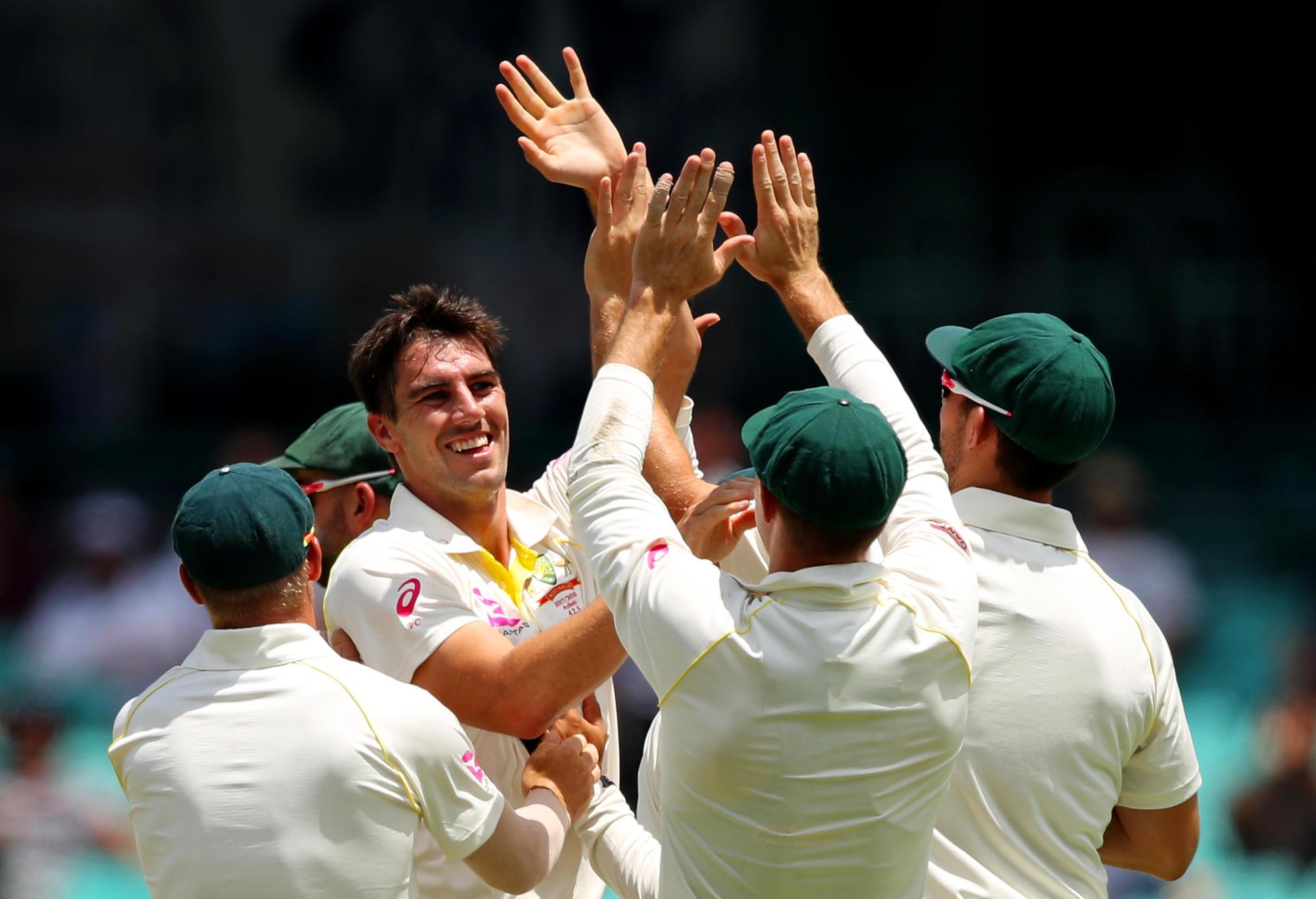 Pat Cummins celebrates a wicket.