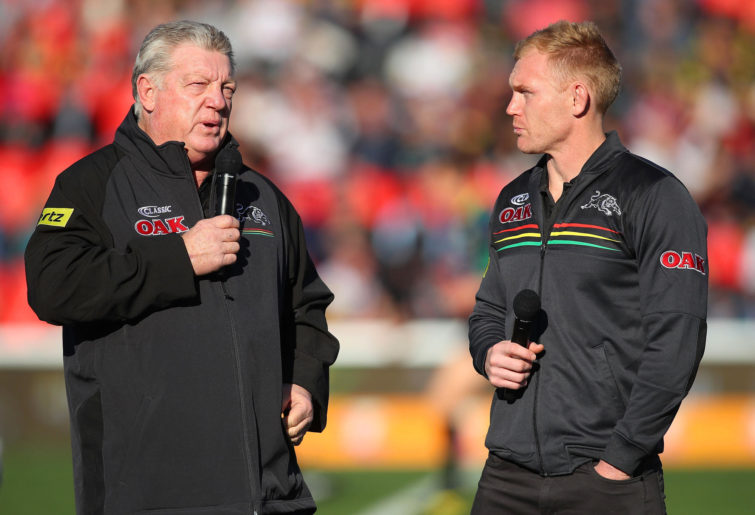 Phil Gould talks with Peter Wallace on the field.