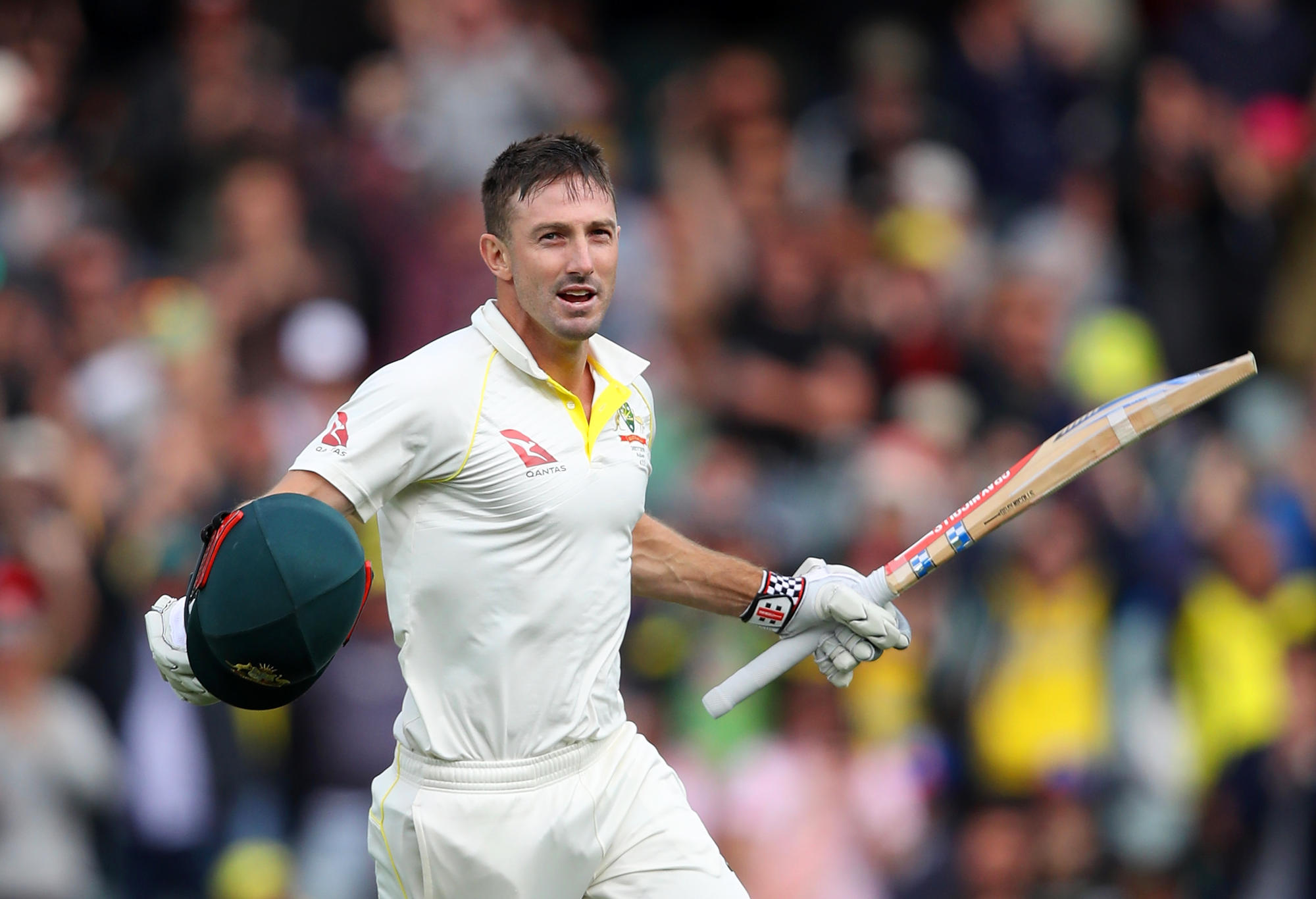 Shaun Marsh celebrates a ton