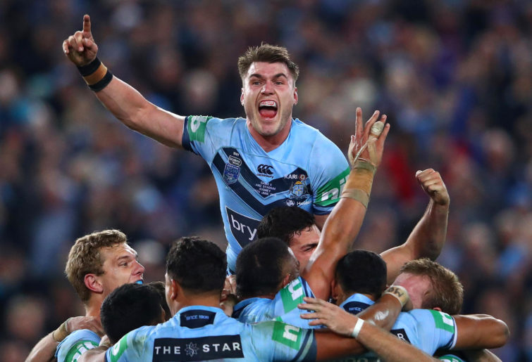 Angus Crichton celebrates