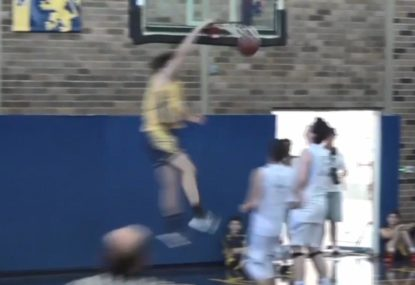 Forward slams down crazy one-handed under the rim dunk