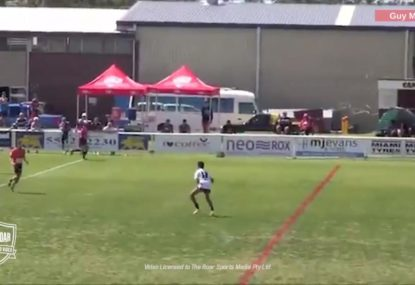 Kid steps through a sea of defenders on the kick return to score