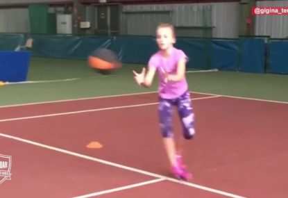 Young tennis hopeful showing perfect form in training