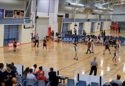High school basketballer sinks INCREDIBLE three-quarter court shot