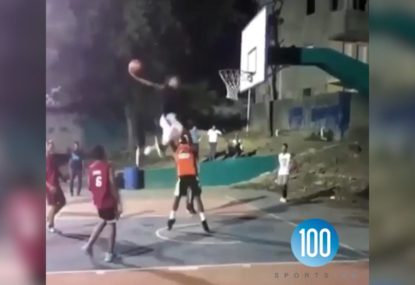Player hangs in the air for days before completing an outrageous dunk!