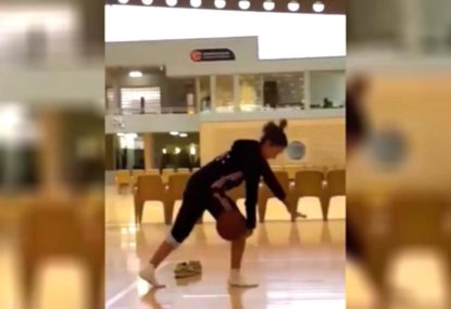 Gymnast spectacularly sinks free-throw... with her legs!