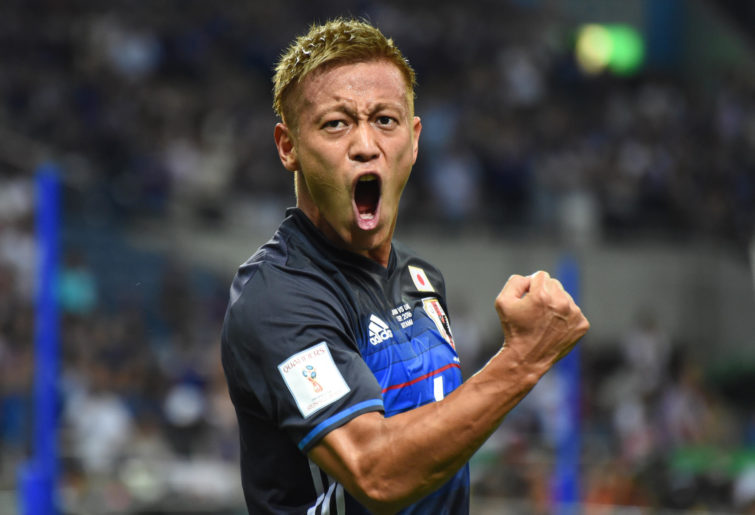 Keisuke Honda celebrates after scoring a goal