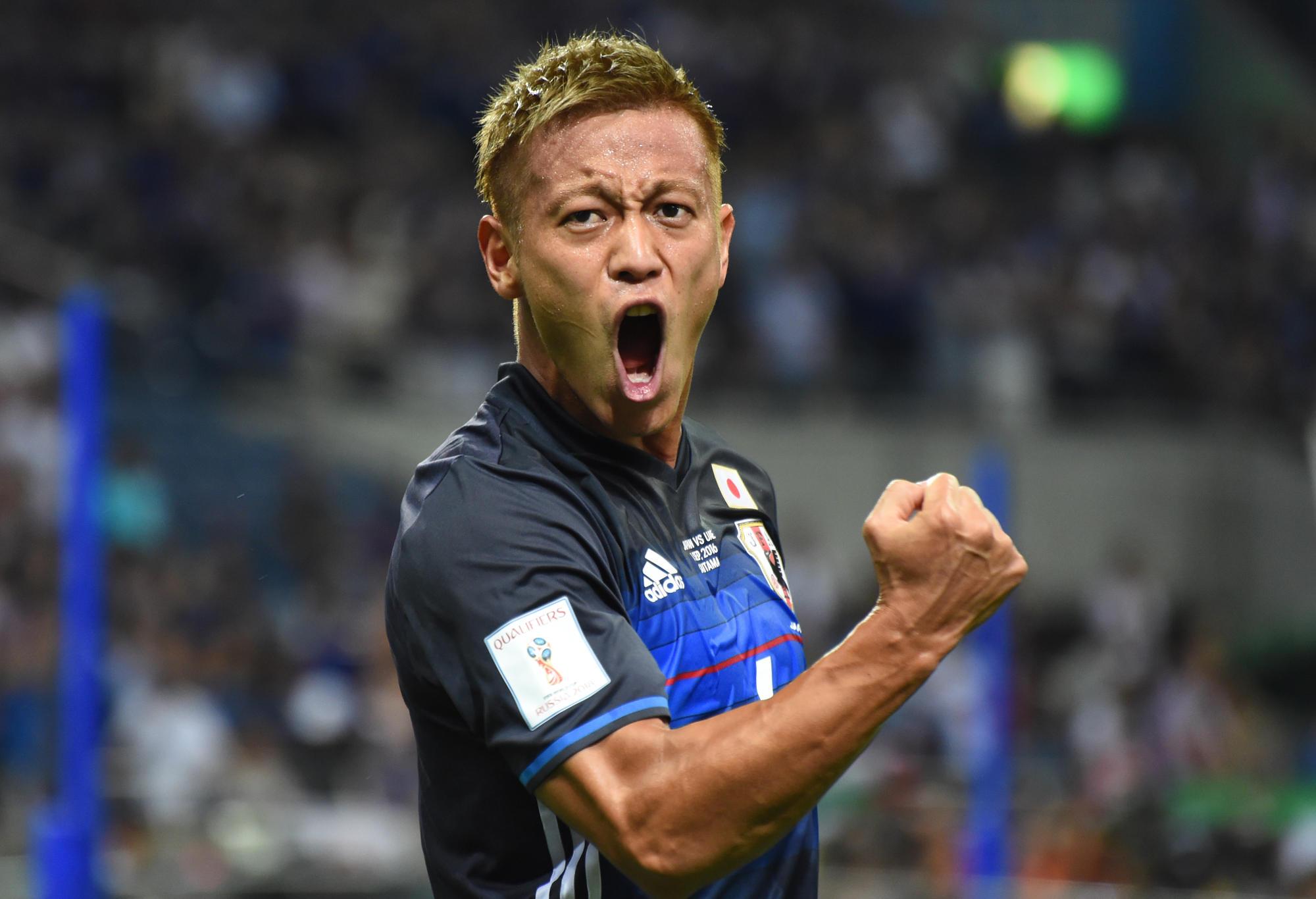 Keisuke Honda celebrates after scoring a goal