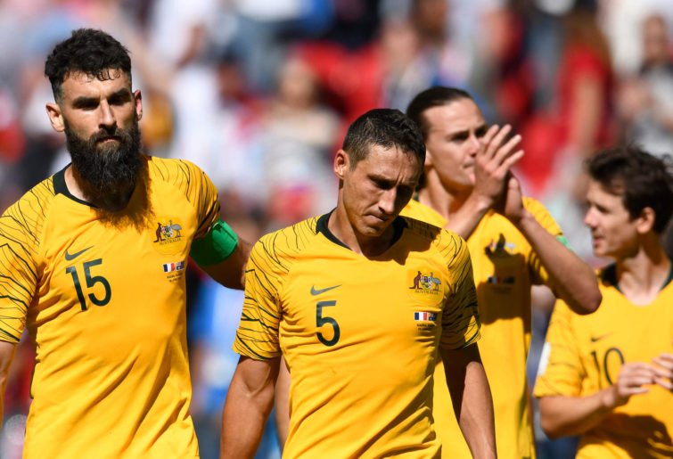 Mark Milligan and Mile Jedinak react after the Scceroos' loss to France