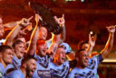 Blues players lift the Origin shield