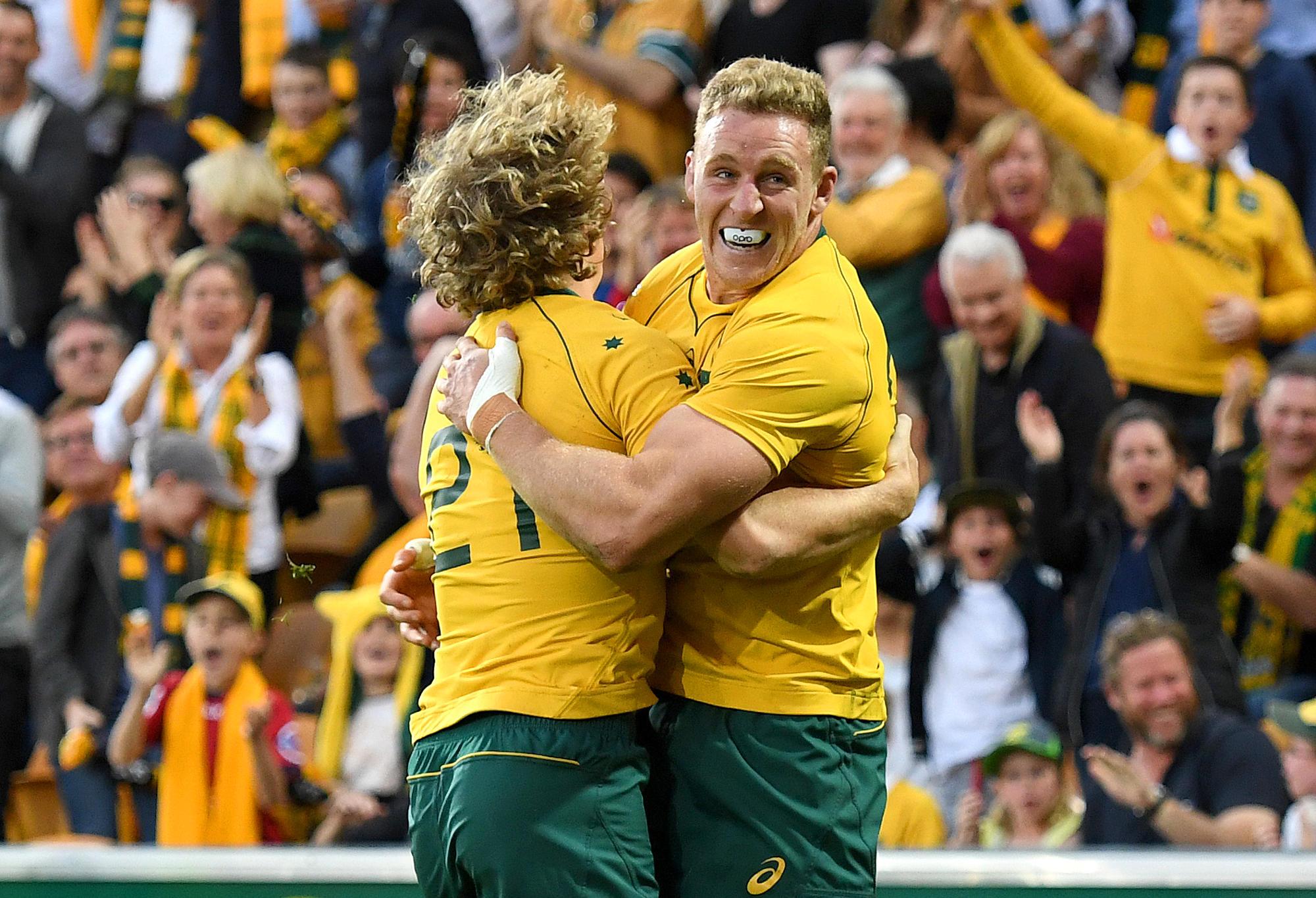 Wallaby Joe Powell celebrates with Reece Hodge