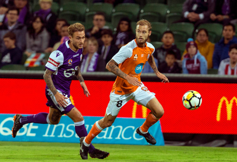 Adam Taggart of the Glory attacks Jacob Pepper of the Roar at nib Stadium on April 14, 2018 in Perth, Australia.