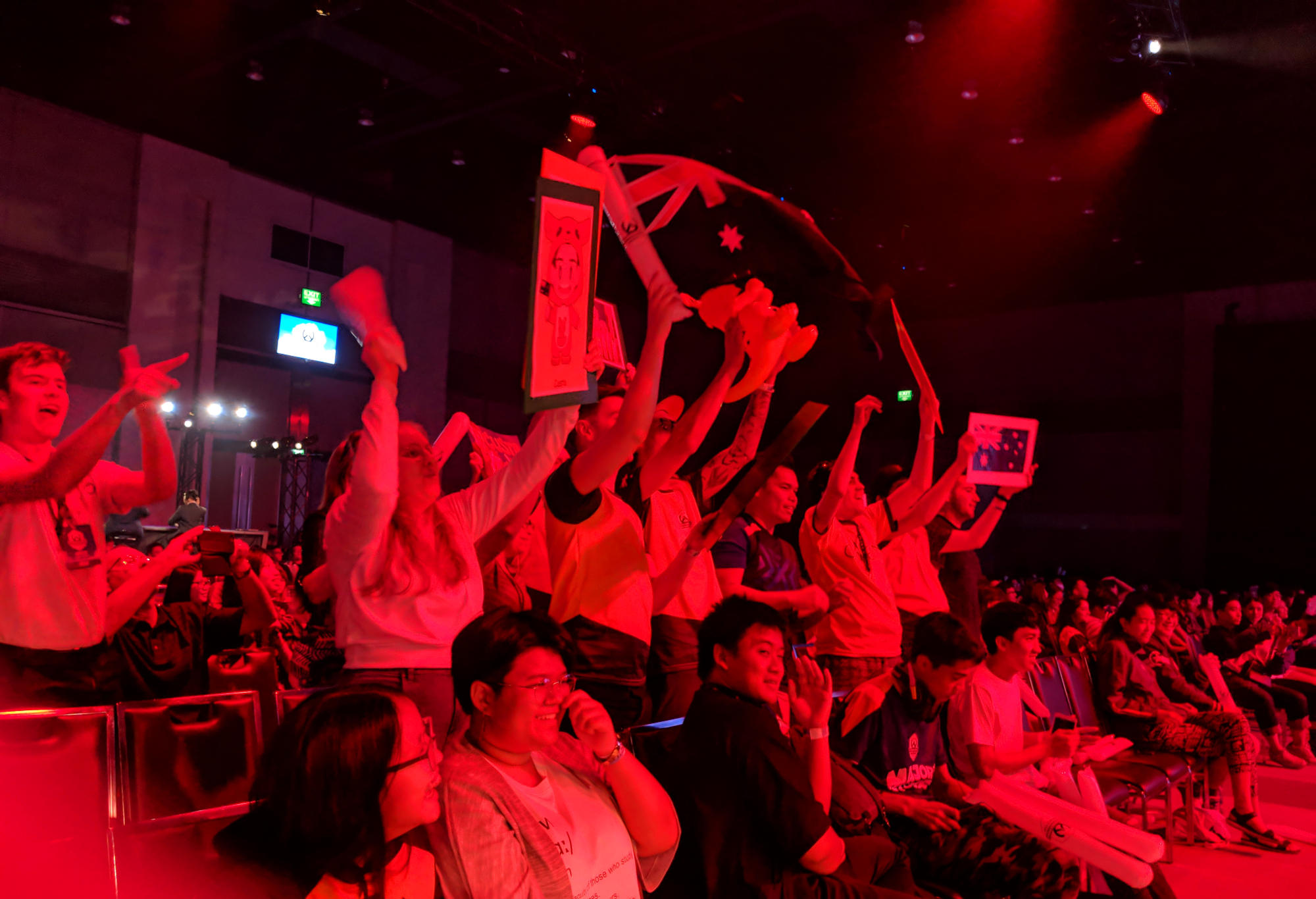 Australian esports fans celebrate a 4-0 victory by their team over Thailand at the 2018 Overwatch World Cup.