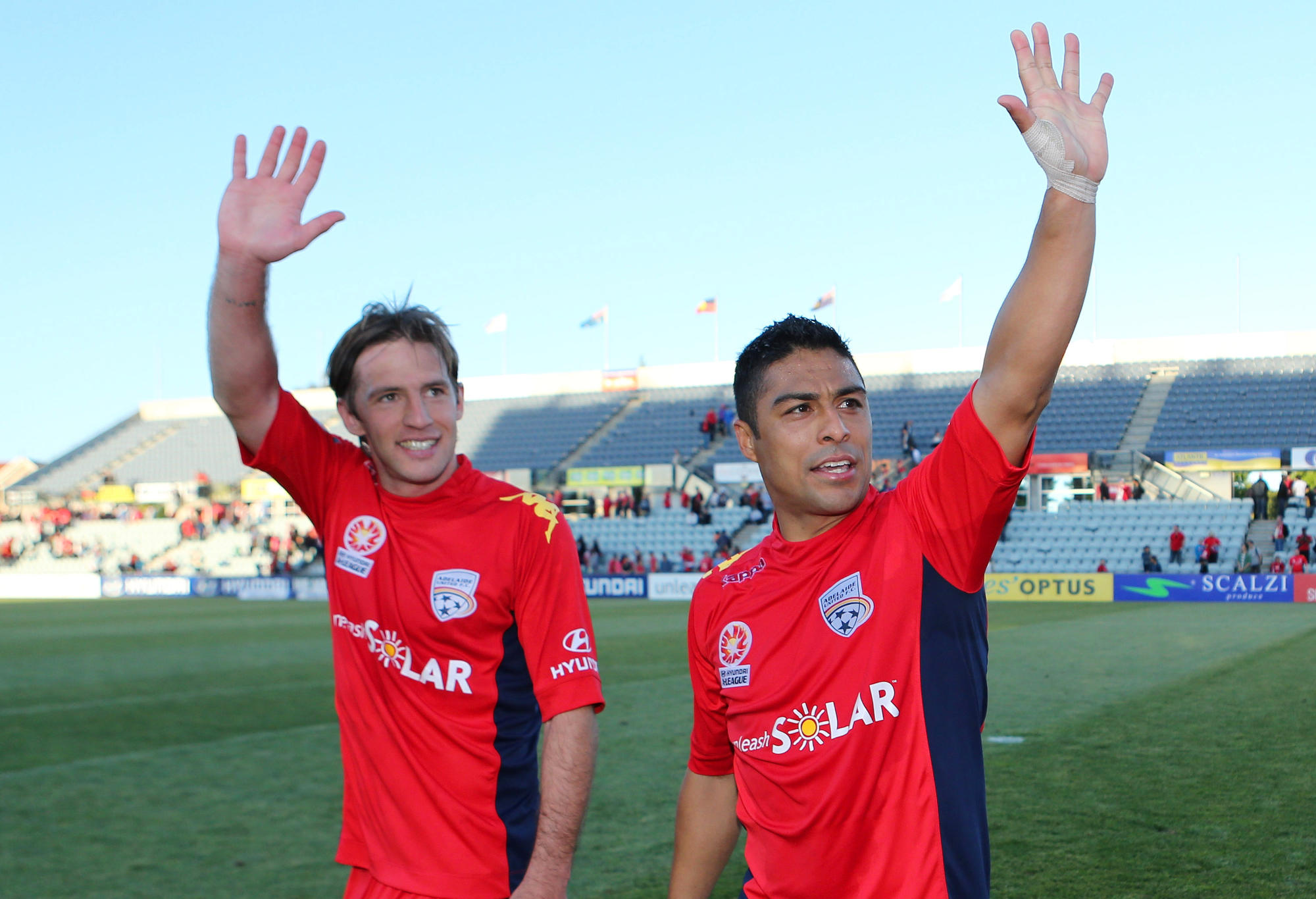 Jeronimo Neumann (L) and Cassio (R) of Adelaide celebrate
