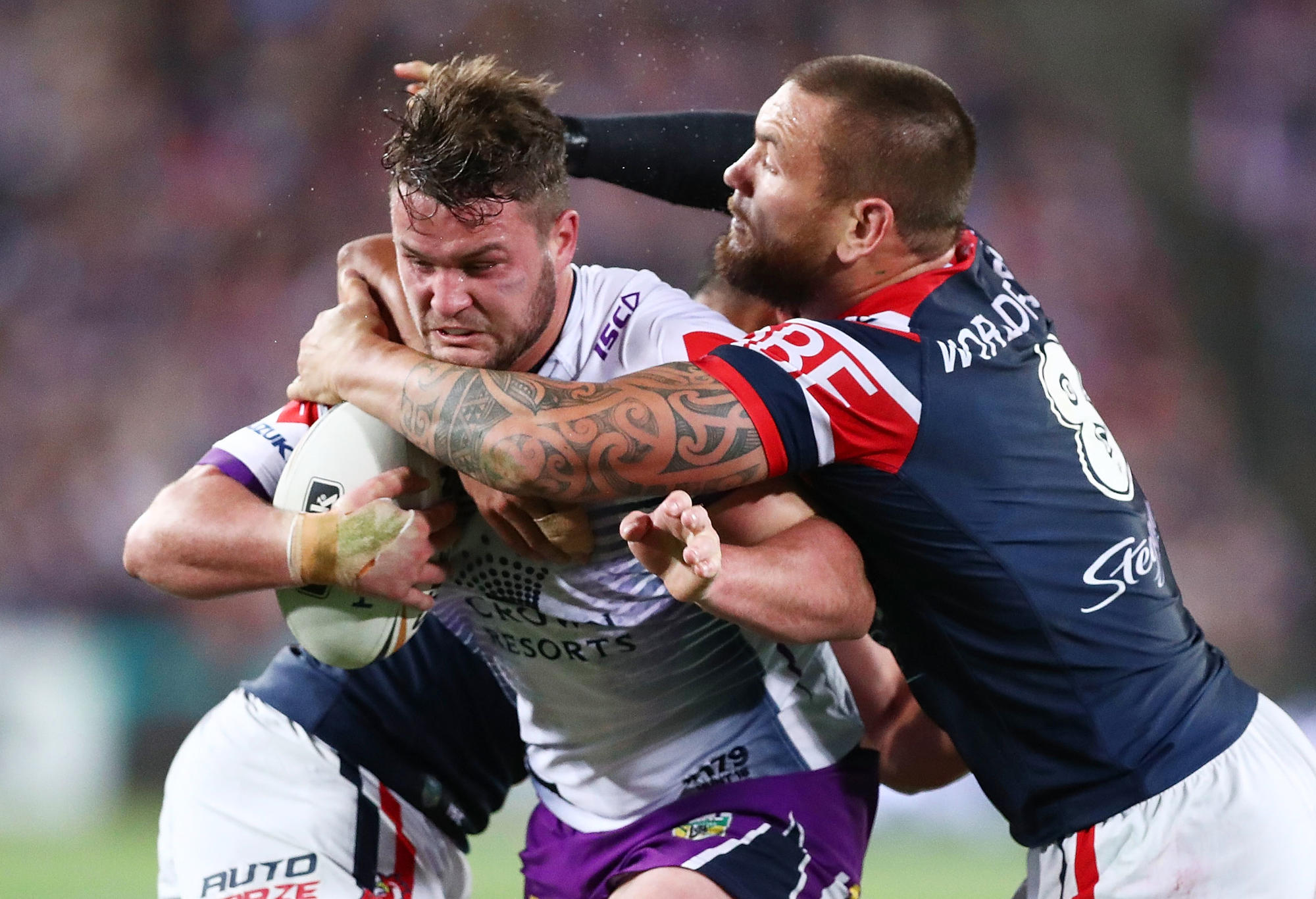 Joe Stimson of the Storm is tackled during the 2018 NRL Grand Final.