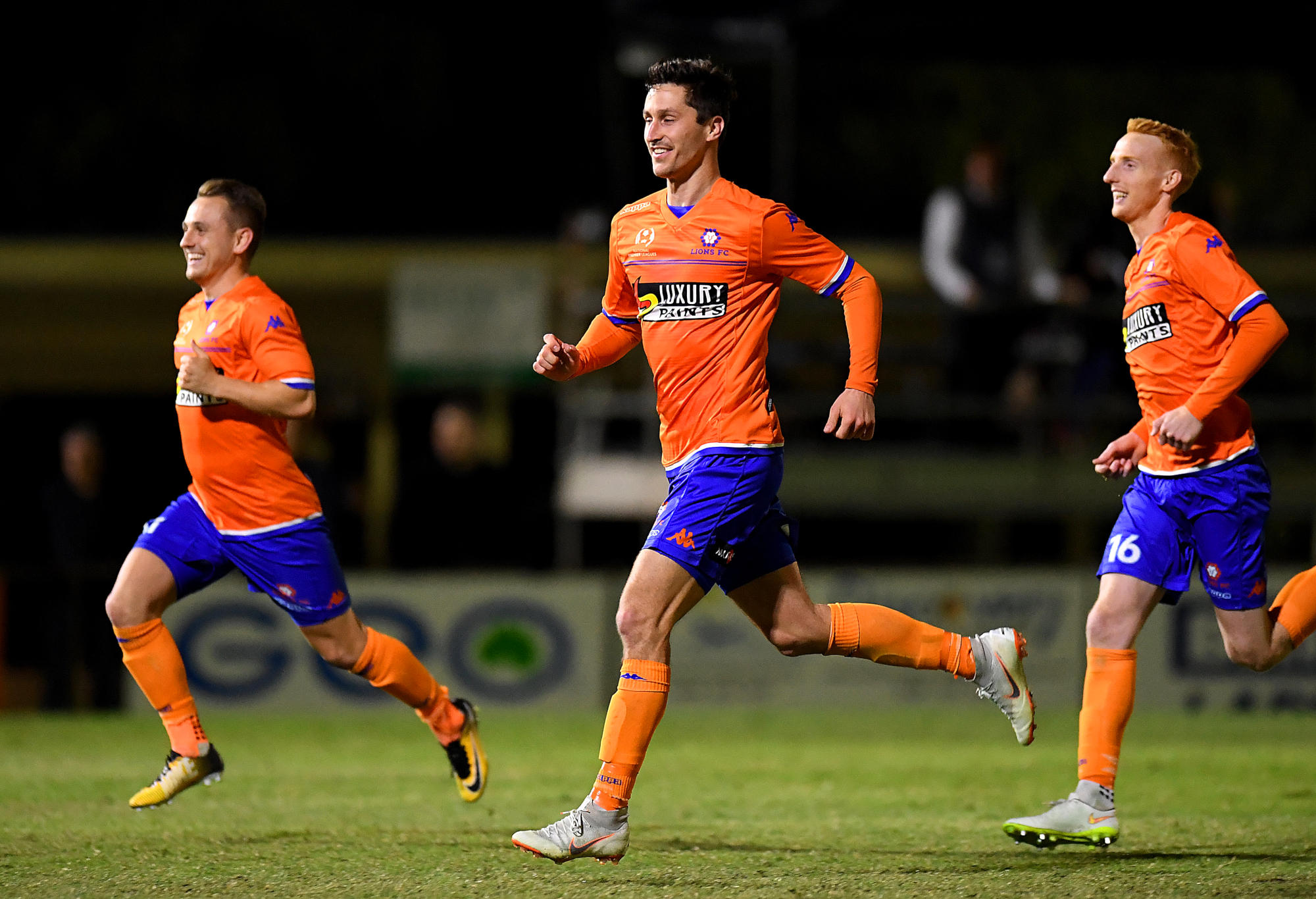 Lions FC players celebrate their victory after a penalty shoot-out against Heidelberg United.