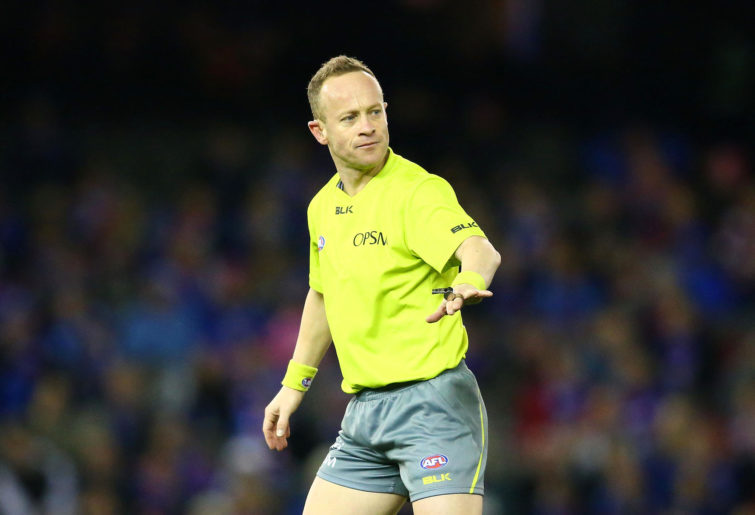 Umpire Ray Chamberlain gestures during the round 18 AFL match between the Western Bulldogs and the St Kilda Saints at Etihad Stadium on July 23, 2016 in Melbourne, Australia.