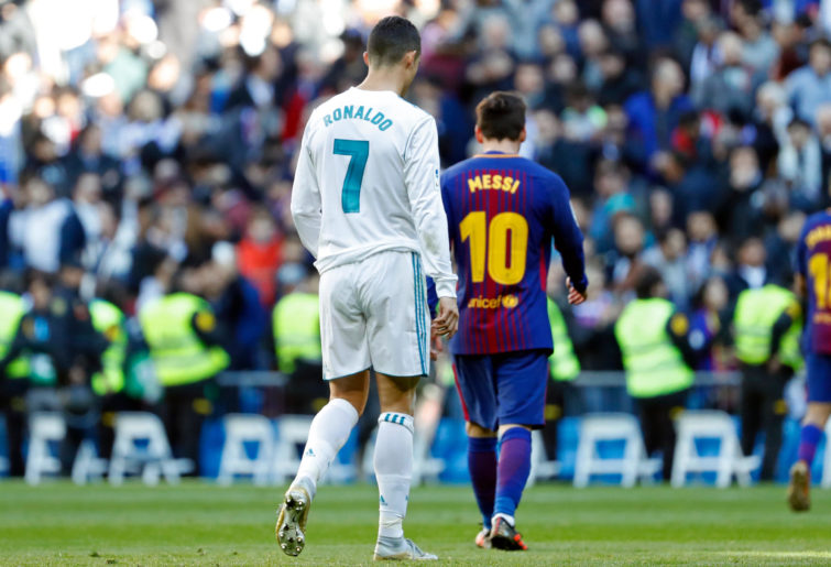 Cristiano Ronaldo of Real Madrid and Lionel Messi of Barcelona looks on during the La Liga match between Real Madrid and Barcelona at Estadio Santiago Bernabeu on December 23, 2017 in Madrid, Spain.