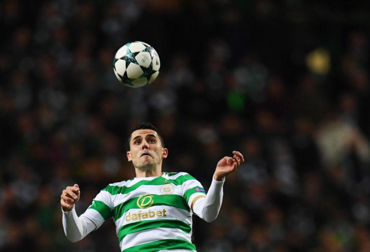Celtic's Australian midfielder Tom Rogic heads the ball.
