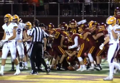 Game-winning intercept causes pandemonium as entire team storms field in celebration